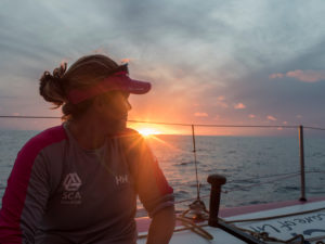October 21, 2014. Leg 1 onboard Team SCA. Sally Barkow takes time to admire the sunset.
